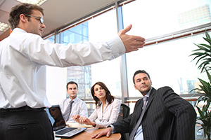 image of man giving  presentation in an office