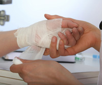 putting a bandage on a patients hand